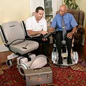 A Hoveround mobility specialist explains wheelchair safety tips to a new owner