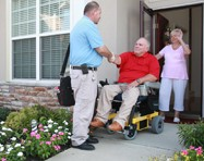 A Hoveround RTS greets a customer