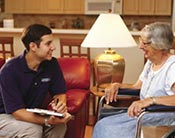 A certified mobillity specialist working with a client