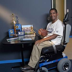 Coach Sonny with his trophies and his Hoveround
