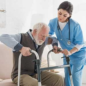 Elderly gentleman struggles to get up from chair for his mobility exam
