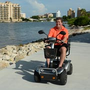A baby boomer enjoying their power mobility scooter