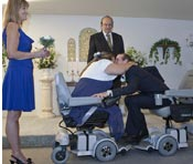 Paul kisses the bride as their wedding comes to a close