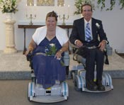 Mr. and Mrs. Galewski roll down the isle after being introduced as husband and wife