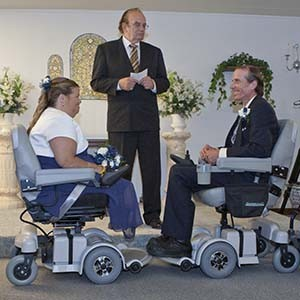 Paul and Cheryl prepare to take their vows from their Hoverounds