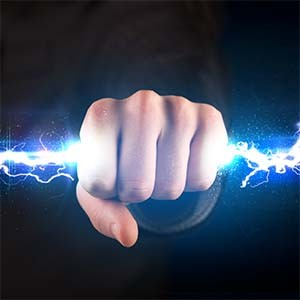 A hand holding a bolt of electricity to highlight battery charger issues