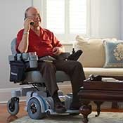 Hoveround user chatting with a friend