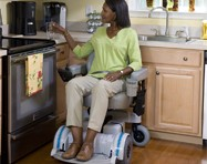 Woman preparing dinner in her Hoveround power chair