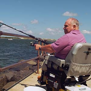 Wayne King enjoys fishing on the pier from his Hoveround