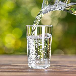 A sparking clear glass of water helps to keep you healthy