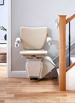The all-new H1100 stair lift at rest at the bottom of the staircase