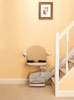 Hoveround's H950 Compact stairlift at the bottom of the stairs