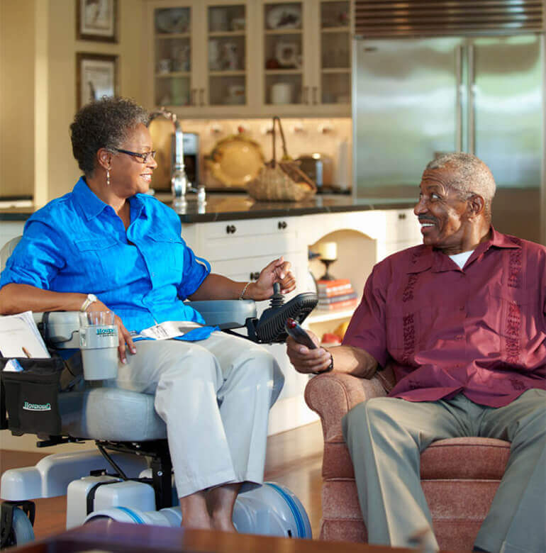 Older couple enjoying home living in a Hoveround power wheelchair