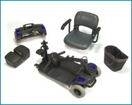 A disassembled travel scooter