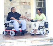 Bariatric and standard motorized wheelchairs side-by-side